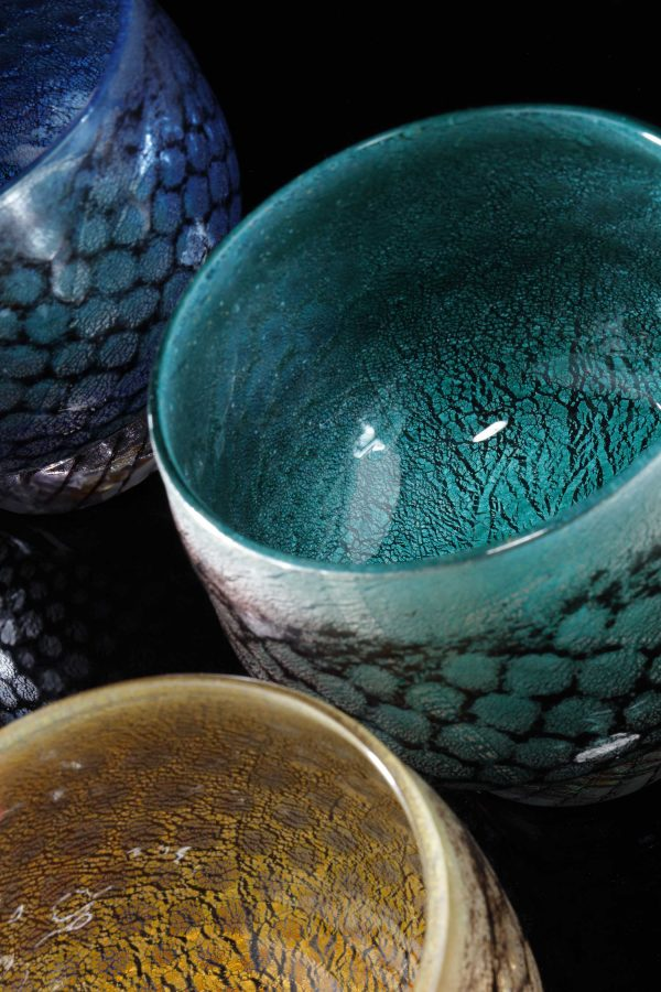mermaid bowl by allister Malcolm. colourful patterned glass with sterling silver leaf